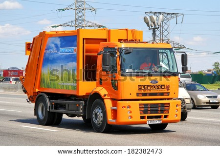 Moscow, russia - june 2, 2012: orange ford cargo garbage truck at the