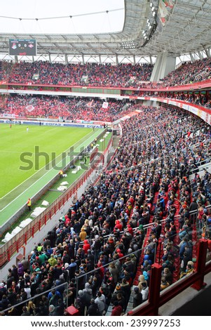 MOSCOW, RUSSIA - MAR 30, 2014: Lot of fans watching football at the stadium Locomotive