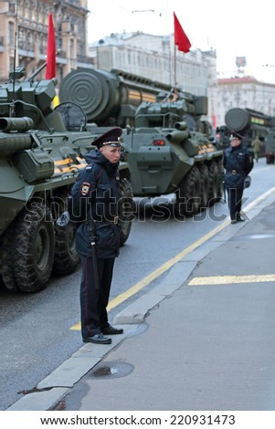 MOSCOW, RUSSIA-MAY 05, 2014: Rehearsal celebration of the 69th anniversary of the Victory Day (WWII). A police cordon around military equipment on Tverskaya street prepares to travel to the Red Square