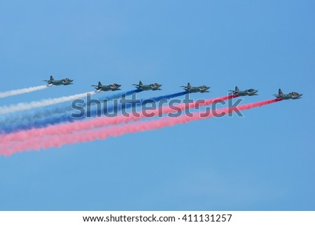 Moscow, Russia - May 9, 2015: The group of Russian fighters Sukhoi Su-25 painted a Russian flag in the sky at Parade of Victory in World War II May 9, 2015 in Moscow