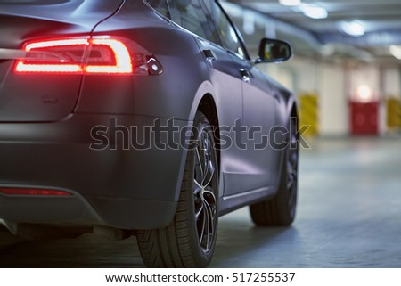 MOSCOW, RUSSIA - NOV 11, 2015: Tesla S car stands at underground parking. The Tesla Model S produced by Tesla Motors, and introduced in June 2012.