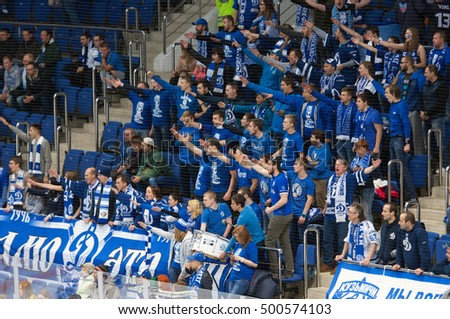 MOSCOW, RUSSIA - OCTOBER 12, 2016: Unidentified fans on tribune during hockey game Dynamo Moscow vs Slovan Bratislava on Russia KHL championship. Slovan won 5:3