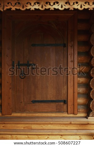 Moscow, Russia - October 13, 2016: Wooden door, detail of renovated ancient Tsar Alexis palace in Kolomenskoye manor