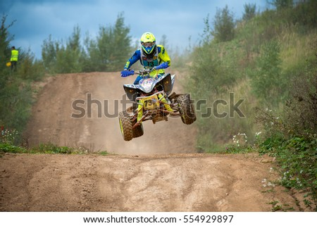 "MOSCOW, RUSSIA - SEPTEMBER 10, 2016: Jan  Elagin 73 (STC Start, Serpukhov), class ATV, in the 4 stage of the XSR-MOTO.RU Cross Country in Moscow, Park ""Velyaminovo"""
