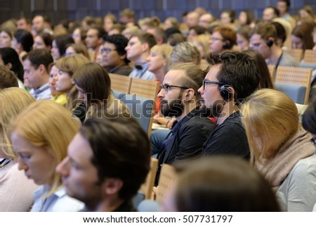 Moscow, Russia - September 2, 2016: People attend Digital Marketing Conference in Russia Today information agency big hall at day time.