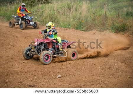 "MOSCOW, RUSSIA - SEPTEMBER 10, 2016: Sergey Styopkin 32 (Sport ATV, Maloyaroslavets), class ATV, in the 4 stage of the XSR-MOTO.RU Cross Country in Moscow, Park ""Velyaminovo"""