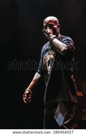 MOSCOW - 18 SEPTEMBER,2014 : Famous rap singer Earl DMX Simmons performing live music show in night club.Hip hop star singing on stage.Rapper on scene.Concert lighting,crowded nightclub.Live rap star