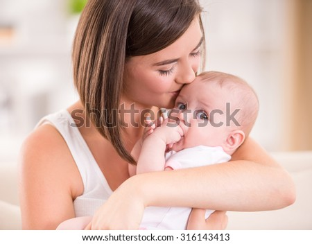 Mother and baby are kissing and hugging. Happy Family.