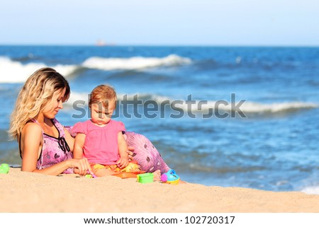 Mother and daughter on the banks of the sea
