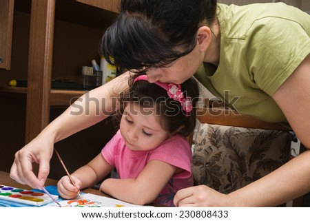 Mother and daughter paint a picture