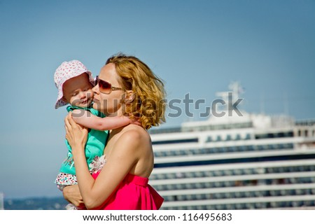 mother and her baby on the sea