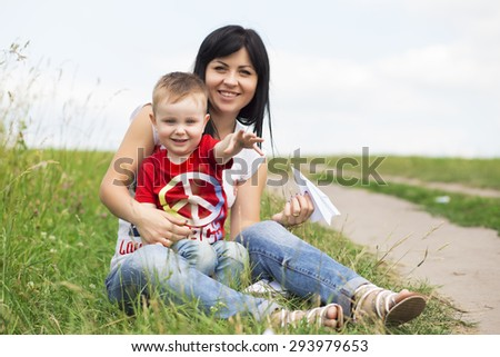 Mother and her child play on the nature