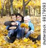 Mother and her childrens are playing in autumn park. - stock photo
