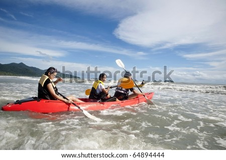 Mother and son in an ocean going kayak