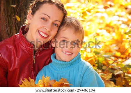 Mother and son in autumn wood