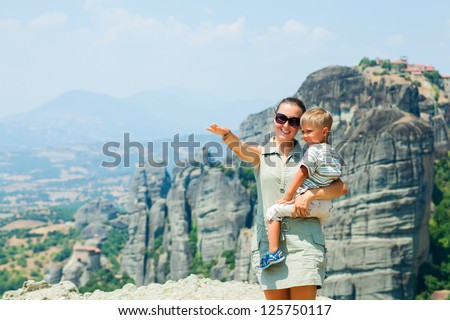 Mother and son looking at the town of Kalambaka bird's eye view. Meteora, Greece.