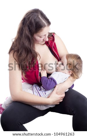 Mother breast feeding her little girl