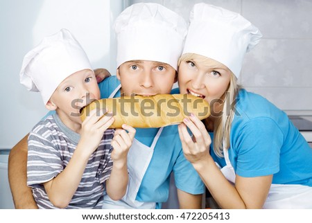 mother, father and son in the kitchen with bread