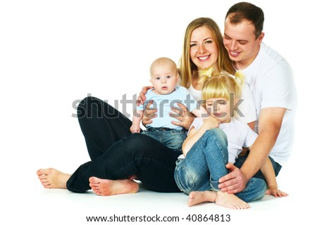 mother, father, daughter and son sitting on floor