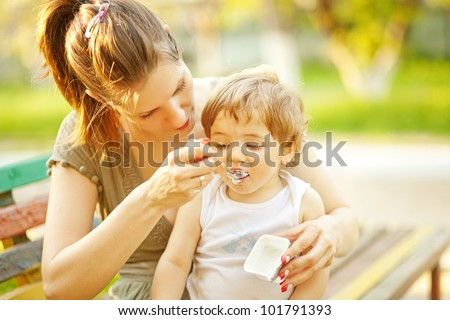 Mother feeding baby food