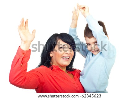 Mother holding her son and both cheering and raise their hands isolated on white background