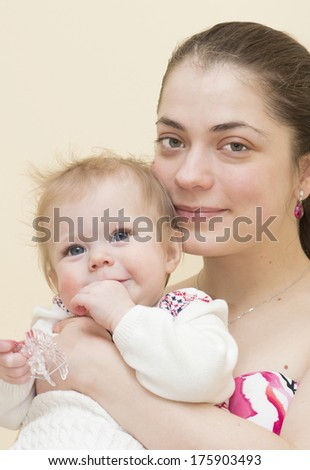Mother holds the baby of 9 months on hands.