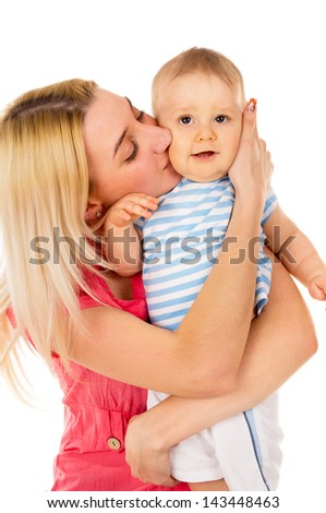 mother kisses her baby isolated on white background
