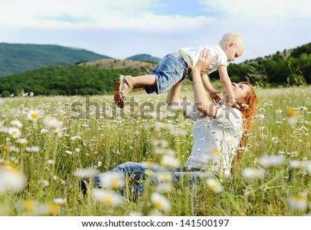 mother  playing with  her son in field