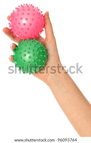 Mother stretches two massage balls for the children's hands development to her baby