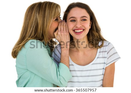 mother whispering something at his daughter