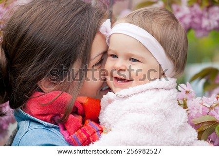 Mother with baby in spring garden
