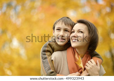 Mother with boy in autumn park