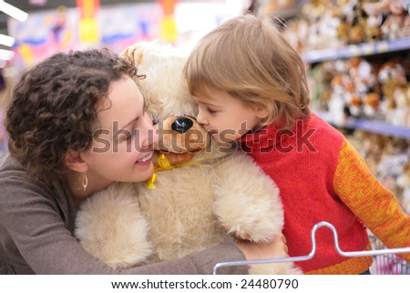 Mother with daughter and soft toy
