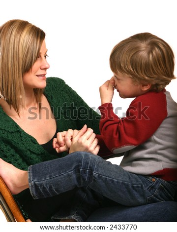 Mother with preschool boy against white background playing