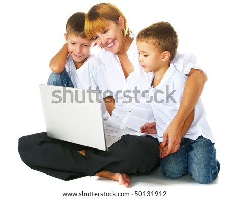 mother with two sons using laptop