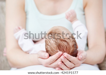 Motherhood. newborn baby on mother hands