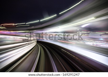 Motion blur of a city and tunnel from inside a moving monorail somewhere in Japan