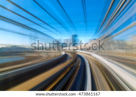 Motion blur of train moving inside tunnel in Odaiba, Tokyo, Japan