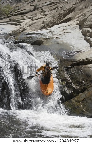 Motion blur shot of a high angle view of a Caucasian man kayaking