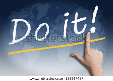 "Motivation text ""Do it!"" with a hand pointing to it on blue background with a world map"