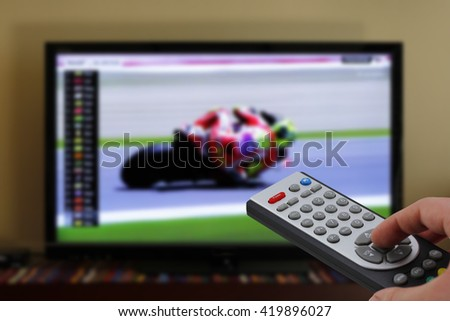Motorbikes race in television, zapping with remote control