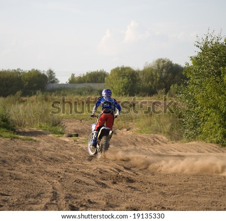Motorcyclist in action. Ready for jump.