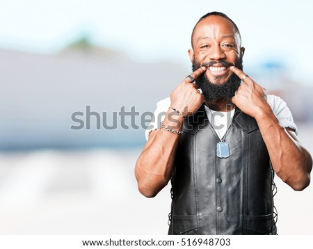 motorcyclist man smiling gesture
