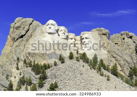Mount Rushmore National Memorial, symbol of America located in the Black Hills, South Dakota, USA. Image with blue space for added text or for presentations.