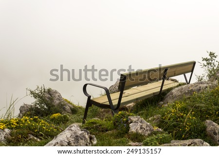 Mountain bench, cloudy day