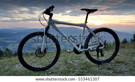 Mountain bike on top of the hill.