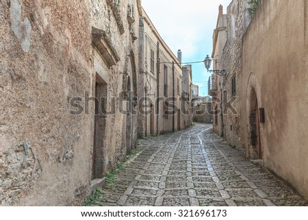 Mountain Fortress and Village of Erice on Sicily, Italy. Amazing medieval Mediterranean stone buildings and houses. Historical location and popular travel destination.