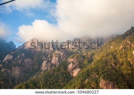 Mountain Huangshan Yungu cableway(the mountain in the back)area scenery. Mountain Huangshan is World cultural and natural heritage. It is one of the chief tourist attractions in China.