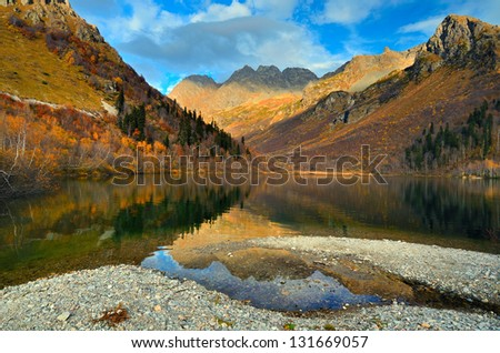 Mountain lake in autumn with beautiful reflection of blue sky