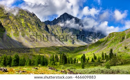Mountain landscape at edge of forest . Eastern Sayan . Russia